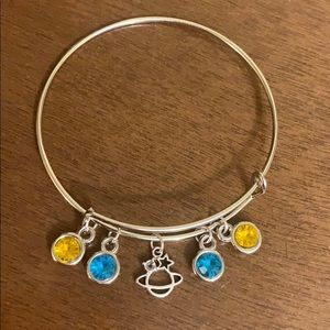 A planet blue and yellow bracelet.